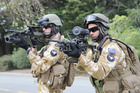 Private Chris Thomson, left, holding a Steyr Assault Rifle configured with a grenade launcher.