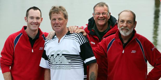 Rescued kayaker Mark Morgan with his Coastguard rescuers - Karl Leathley, skipper John Haselden and David Berg.