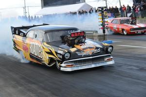 Hamilton's Morice McMillen (near lane) executes a big smokey burnout. Photo / Colin Smith