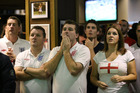 Father and son Tony and Ben Parsonage and Zena Thomas react during England's game against Uruguay. Photo / New Zealand Herald / Greg Bowker