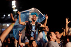 Argentina fans cheer during halftime entertainment at the FIFA Fan Fest area on Copacabana beach in Rio de Janeiro. Photo / AP