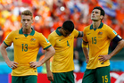 From left, Australia's Oliver Bozanic, Australia's Tim Cahill and Australia's Mile Jedinak walk off the pitch following the team's 3-2 loss to the Netherlands. Photo / AP