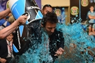 NSW Blues coach Laurie Daley celebrates after his team won the 2014 State of Origin series. Photo / AAP