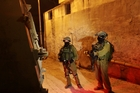Israeli soldiers take part in the search for the three missing teenagers near the West Bank city of Hebron. Photo / AP