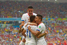 Chile's Eduardo Vargas, centre, celebrates with teammates after scoring the opening goal against Spain. Photo / AP
