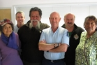 Sergeant Peter Masters, centre, on his last day at work in Paihia with workmates and community members Hinehou Apiata, left, Constable Edwin