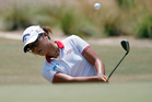 Lydia Ko, of New Zealand, chips to the first hole during the first round of the U.S. Women's Open. Photo /AP