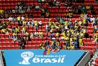 Ecuador fans sit between unoccupied seats during the group E World Cup soccer match between Switzerland and Ecuador. Photo / AP