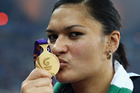 Valerie Adams celebrates with her gold medal at the Delhi 2010 Commonwealth Games. Photo / Getty Images
