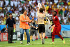 A pitch invader is approached by Sulley Muntari of Ghana as head coach Joachim Loew of Germany (L) looks on during the 2014 FIFA World Cup Brazil Group G match. Photo / Getty Images
