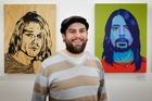 Artist Mike Marsh with his paintings of Kurt Cobain (left) and Dave Grohl of Nirvana  Photo/Bevan Conley