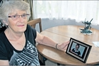 Lee Hall with photo of her missing son Brett Hall. Photo/File