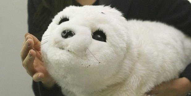 The Paro baby-seal robot has fur, big appealing eyes and can interact with humans. Photo / Getty Images