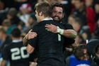 Richie McCaw is hugged by centre Ryan Crotty after their dominant win at Waikato Stadium seals a clean sweep in the series. Photo / Alan Gibson