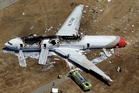 The crash of Asiana Flight 214 at San Francisco airport killed three people. Photo / AP