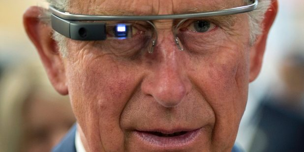 Prince Charles tries on Google Glass. Photo / AP