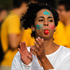 A demonstrator, with the words 'Go Fight' written on her face, blows on a whistle during a protest against the World Cup soccer tournament in Brasilia, Brazil. Photo / AP