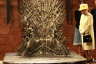 Britain's Queen Elizabeth II visits the throne room at the set of the Game of Thrones TV series in Belfast's Titanic Quarter in Northern Ireland.
