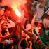 Algeria fans celebrate after Algeria's Islam Slimani scored his side's first goal during the World Cup soccer match between Algeria and Russia at the Arena da Baixada in Curitiba, Brazil. Photo / AP
