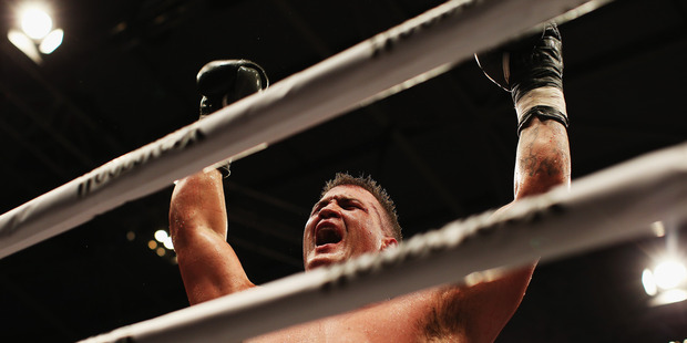 Brian Minto celebrates beating Shane Cameron last December. Photo / Getty Images