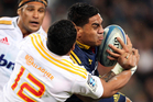 Malakai Fekitoa of the Highlanders crashes into the tackle Bundee Aki of the Chiefs during the round 17 Super Rugby match between the Highlanders and the Chiefs. Photo / Getty Images.