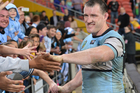 Paul Gallen of the Sharks celebrates with fans after Cronulla ended their five-match losing streak with a win over the Brisbane Broncos at Suncorp Stadium on Friday. Photo / Getty Images