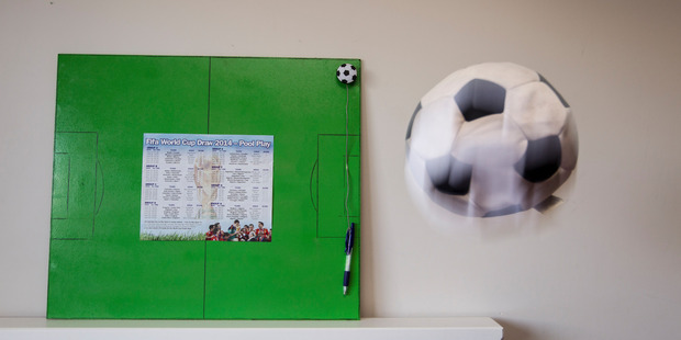 Keep up-to-date with the Football World Cup wall chart board. Photo / Michael Craig