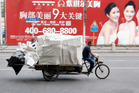 A man with a large load on his cycle-truck in Shanghai, China. Photo / Mark Mitchell
