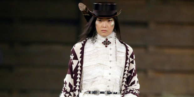 A model walks the runway at Chanel's Metiers d'Art fashion show. Photo / AP images.