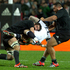 All Blacks players Sam Whitelock and Charlie Faumuina crunch England player, Danny Cipriani. Photo / New Zealand Herald / Alan Gibson
