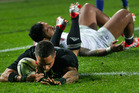 All Blacks player Aaron Smith breaks free from Manusamoa Tuilagi to score during the test match between the All Blacks and England played at Waikato Stadium in Hamilton. Photo / Alan Gibson