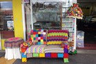 A comfy knitted lounge is warming up Greerton streets as part of this year's yarn bomb project. Photo/Supplied