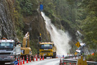 260614bf7 Work is underway to flush out slip risks on State Highway 36 using thousands of litres of water dropped from a helicopter monsoon bucket. 26 June 2014 Rotorua Daily Post Photograph by Ben