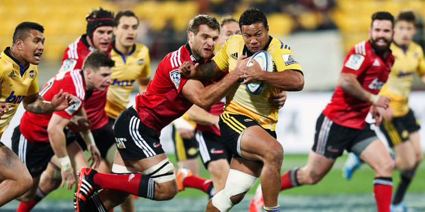 Alapati Leiua of the Hurricanes is tackled by Luke Whitelock of the Crusaders during the round 17 Super Rugby match between the Hurricanes and the Crusaders. Photo / Getty Images.