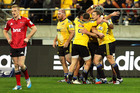 Hurricanes players celebrate the try of Blade Thomson during the round 17 Super Rugby match between the Hurricanes and the Crusaders. Photo / Getty.