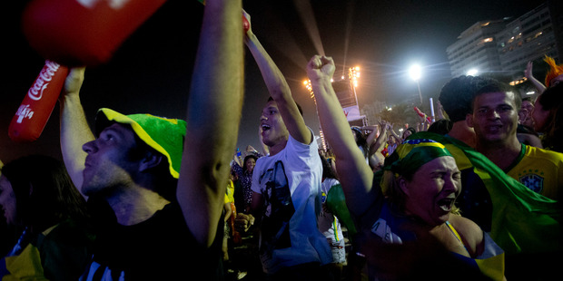 Soccer fans celebrate Brazil's second goal in the World Cup opener against Croatia. Photo / AP