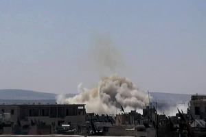 File photo of smoke rising from a building after Syrian military airstrikes. Photo / AP