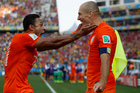 Netherlands' Memphis Depay, left, celebrates with his teammate Arjen Robben after scoring his side's second goal during the group B World Cup soccer match between the Netherlands and Chile. Photo / AP