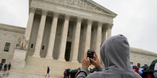 A unanimous Supreme Court says police may not generally search the cellphones of people they arrest without first getting search warrants. Photo / AP