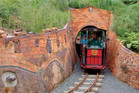Passengers aboard Driving Creek Railway's Possum train emerge from a tunnel. Photo / Supplied