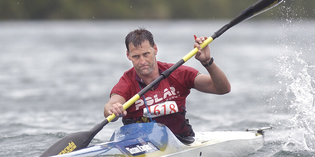 130107bf2 Individual entry Scott Donaldson from Rotorua comes from the kayak leg of the Wild Moa on Lake Tarawera on Saturday 13 January 2007 Daily Post Photograph by Ben Fraser DPM 25Apr14
