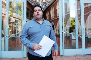 Blogger Cameron Slater outside the Auckland High Court. Photo / Doug Sherring
