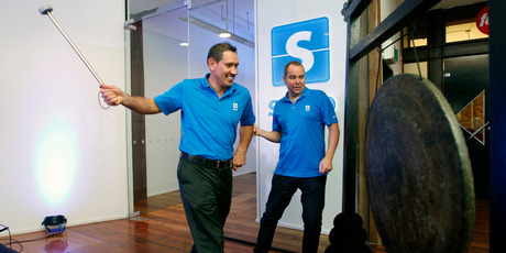 Serko co-founders Bob Shaw (left) and Darrin Grafton  mark the company's listing on the NZX.  Photo / Chris Gorman