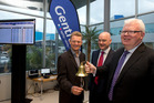 (L-R) Gentrack CEO James Docking, chairman John Clifford with NZX chief executive Tim Bennett during Gentrack sharemarket listing event. Photo / Brett Phibbs