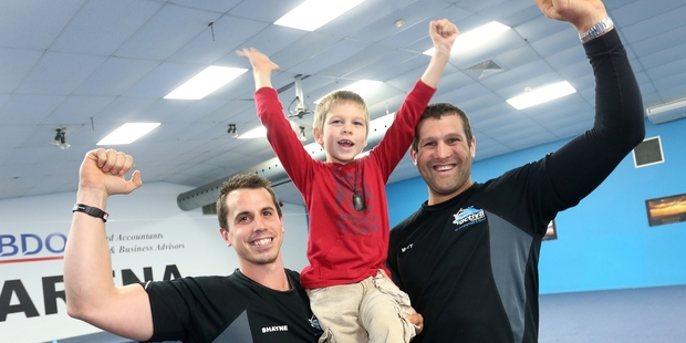 Shayne Dunseath and Matt Harrison of Activ8 Northland with Reuben Leslie, 7. The Whangarei gym hopes to raise funds for Reuben with an indoor rowing world record attempt tomorrow. Photo / Michael Cunningham