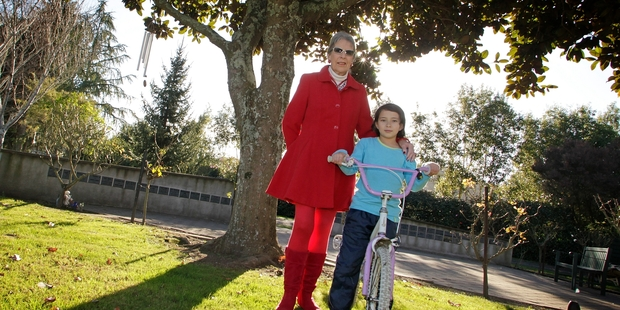 Fiona Donne with granddaughter Christina Donne-Lee under the condemned tree. Photo/Bevan Conley