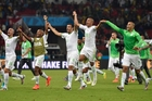 Algerian players run to their supporters to celebrate their first World Cup finals win since 1982. Photo / AP