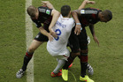 United States' Clint Dempsey gets tangled with Germany's Per Mertesacker, left, and Germany's Jerome Boateng. Photo / AP