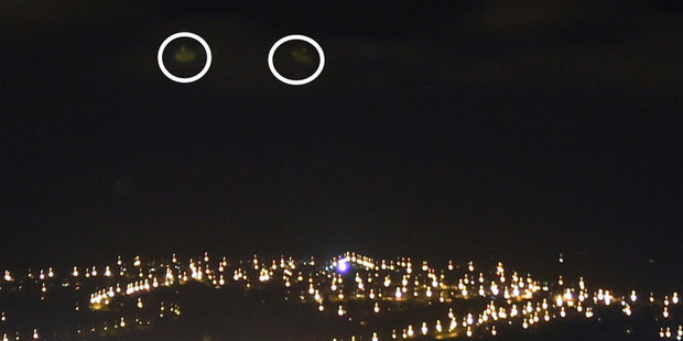 Terence Huang says he took this picture on Monday night - but didn't notice the two circled objects in the sky until yesterday when he uploaded the photo. Photo / supplied to ODT