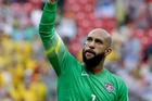 Everton and United States goalkeeper Tim Howard, the real ace for the team, gives a thumbs up to supporters. Photo / AP